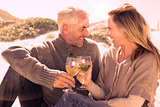 Couple enjoying white wine on picnic at the beach