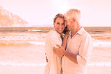 Happy couple hugging on the beach woman looking at camera