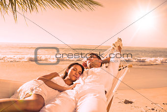 Calm couple napping in a hammock