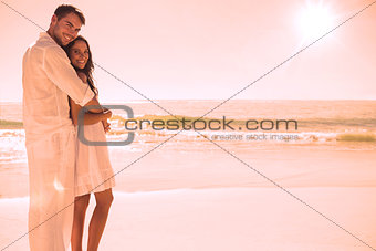 Attractive couple hugging and looking at camera