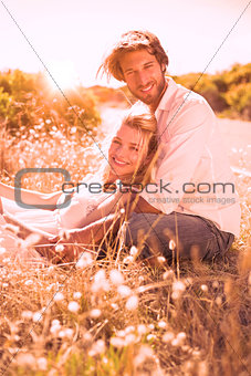 Attractive couple relaxing in the countryside