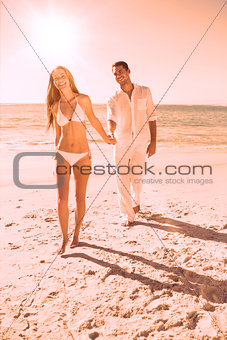Smiling blonde walking away from man holding her hand