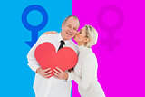 Composite image of older affectionate couple holding red heart shape
