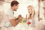 Man proposing marriage to his shocked blonde girlfriend