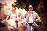 Hip young couple going for a bike ride