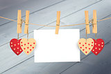 Composite image of hearts hanging on the line