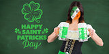 Composite image of irish girl with beer