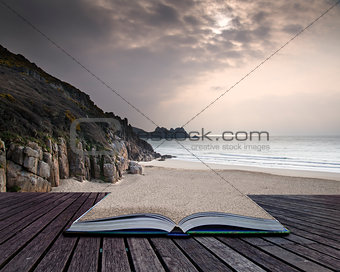 Creative concept pages of book Porthcurno yellow sand beach