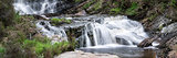 Panorama landscape waterfall detail flowing over rocks in Summer