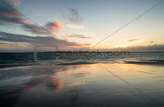Beautiful landscape Summer sunset sky reflected on wet beach