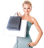 Beautiful female holding shopping bags