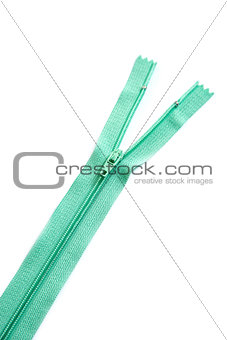 Green zipper isolated on white background