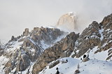 Snowy Dolomites Alps in clouds, winter, Italy, Europe, rocks