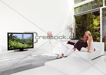 Beautiful Couple Watching TV