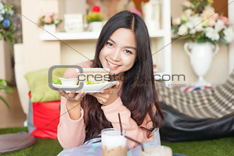 Close up pretty Asian woman eating Sandwich