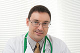 male doctor looking at camera