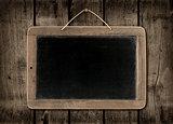 Blackboard on a dark wood wall background