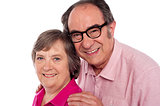 Closeup portrait of smiling aged couple