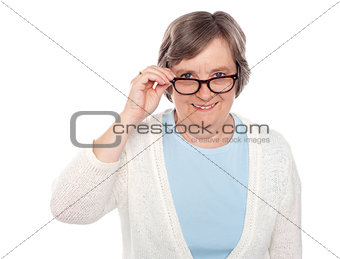 Attractive female holding her eyeglasses