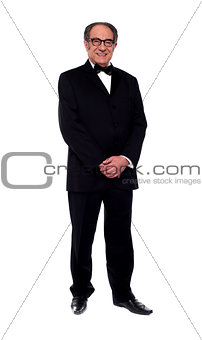 Attractive senior man posing in tuxedo