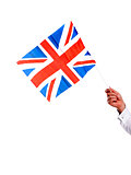 Image of males hand holding UK flag