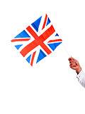 Image of males hand holding UK flag