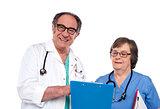 Senior doctors reading medical report