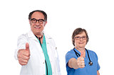 Medical professionals showing thumbs up