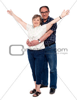 Man hugging his wife from behind