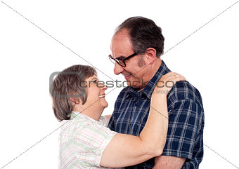 Aged couple in a romantic mood