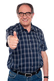 Aged man gesturing thumbs up