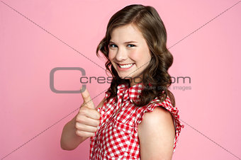 Beautiful smiling girl with ok gesture