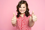 Gorgeous girl showing double thumbs up