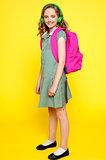 Portrait of a school girl wearing headphones
