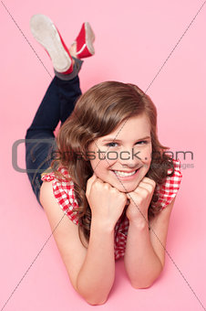 Beautiful girl posing with hands on chin
