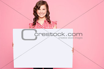 Beautiful girl holding blank billboard