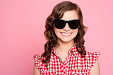Trendy young girl in black goggles