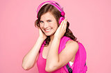 Schoolgirl enjoying music and smiling