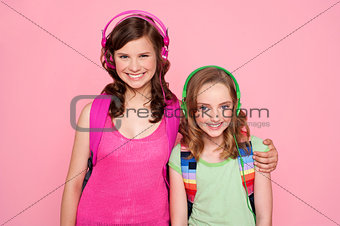 Sisters standing together and enjoying music