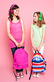 Beautiful teenagers holding school bag