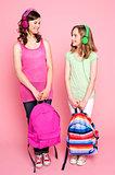 Beautiful teenagers holding school bag