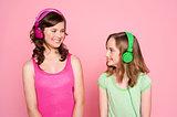 Two teenage friends enjoying music together
