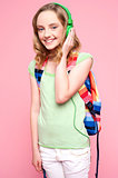 Girl with backpack listening to music