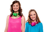 Teenagers posing with headphones around neck