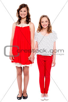 Beautiful sisters holding each others hand