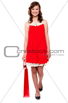 Attractive teenager carrying shopping bag