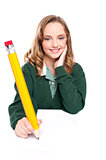 Young girl using an over sized pencil