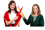 Smiling teenagers making cross sign with pencil