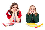 Happy young girls sitting idle with notebooks