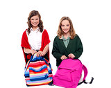 Pretty girls unzipping school bag